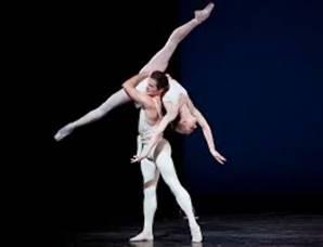 ballet dancers with black backdrop